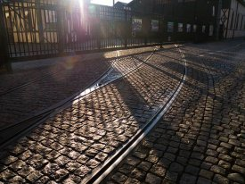 Old Cracow - ornament of old tram rails, january sun rays, no wind...